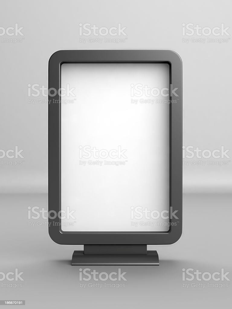 A white blank advertising board with black borders and stand stock photo