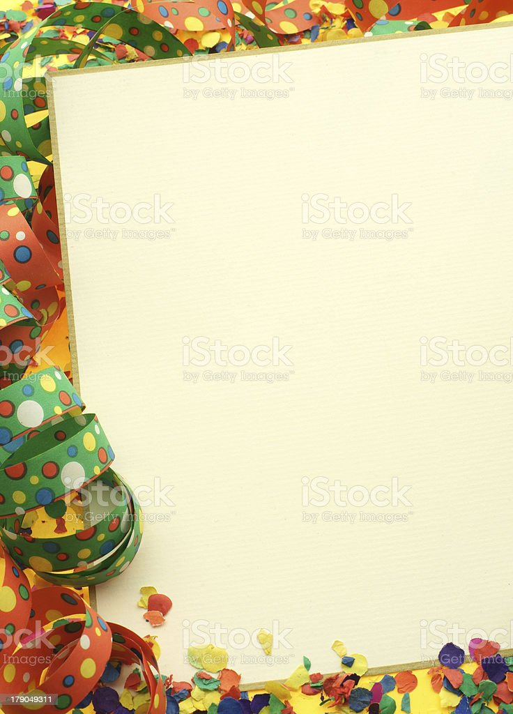 White blank background surrounded by party streamers royalty-free stock photo