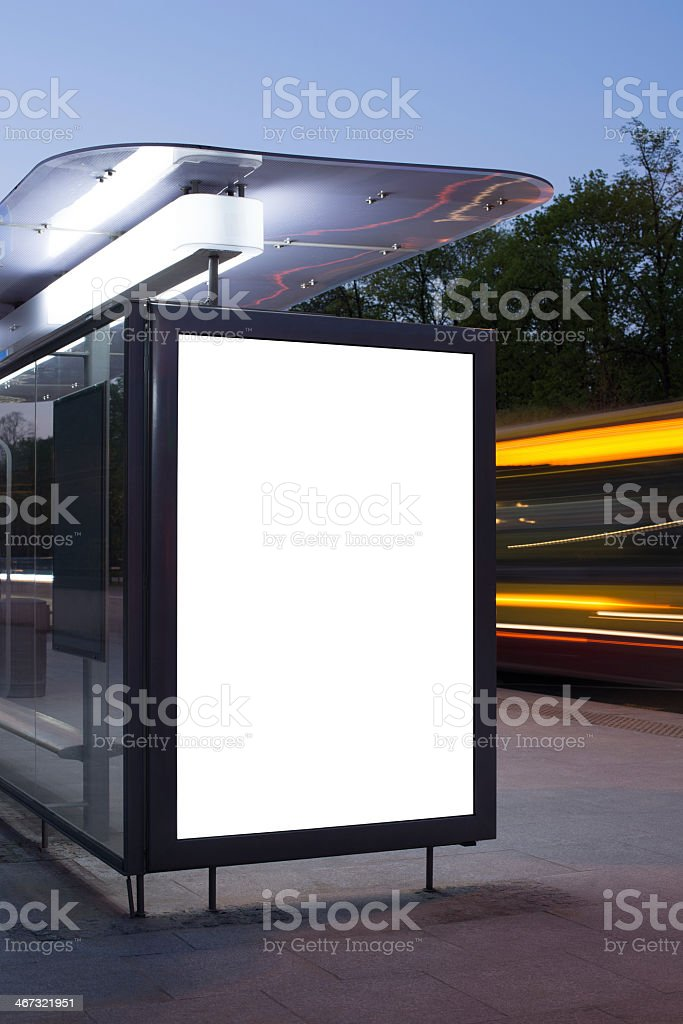 A white blank billboard at night on a bus stop stock photo