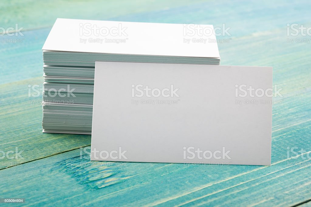 White blank business visit card, gift, ticket, pass on blue stock photo