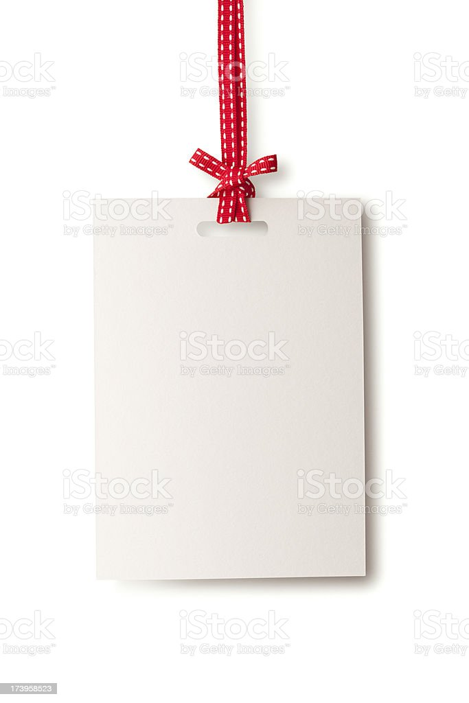 White blank card hanging from red ribbon stock photo