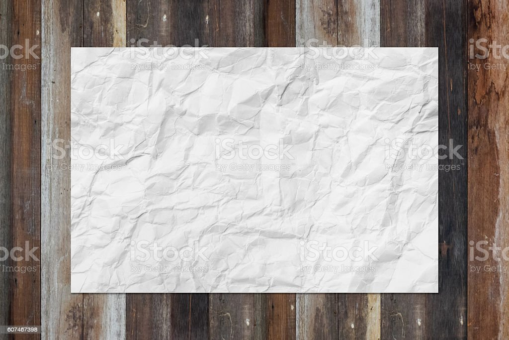 White blank crumpled paper on grunge wooden table stock photo