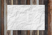 White blank crumpled paper on grunge wooden table