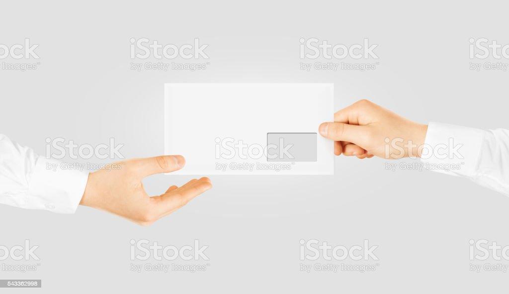 White blank envelope giving hand mockup design present stock photo