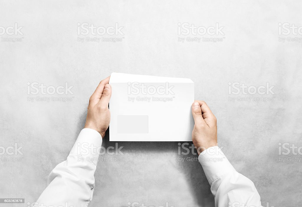 White blank envelope mockup hold in hands. stock photo