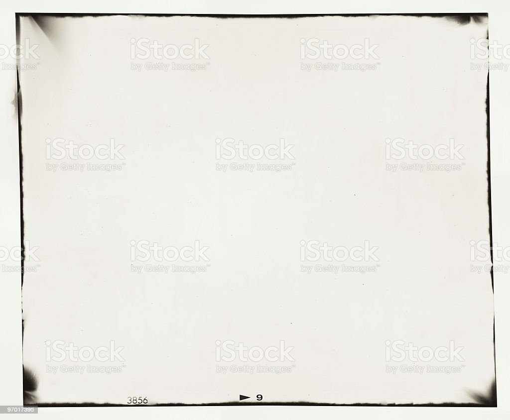 White blank film frame with black smudged borders stock photo