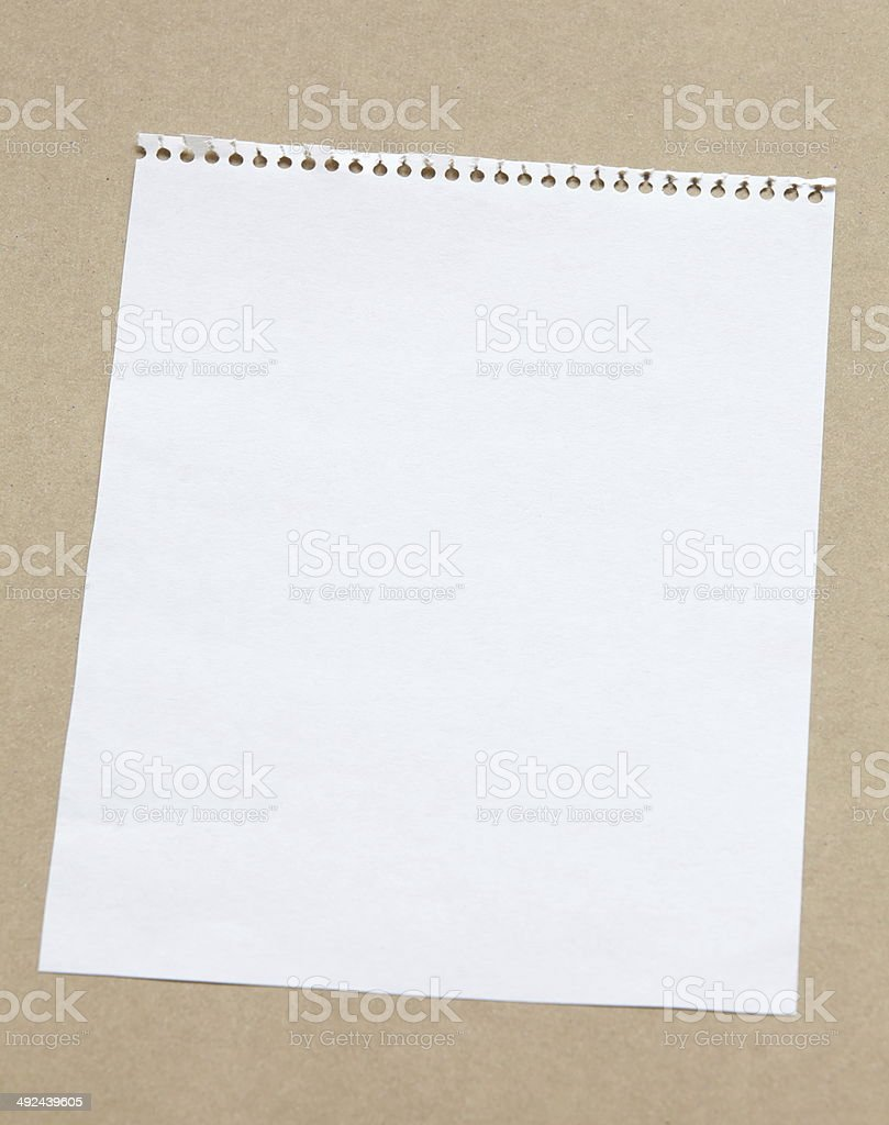 white blank note paper on brown background royalty-free stock photo