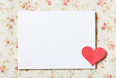 White blank paper card with floral fabric