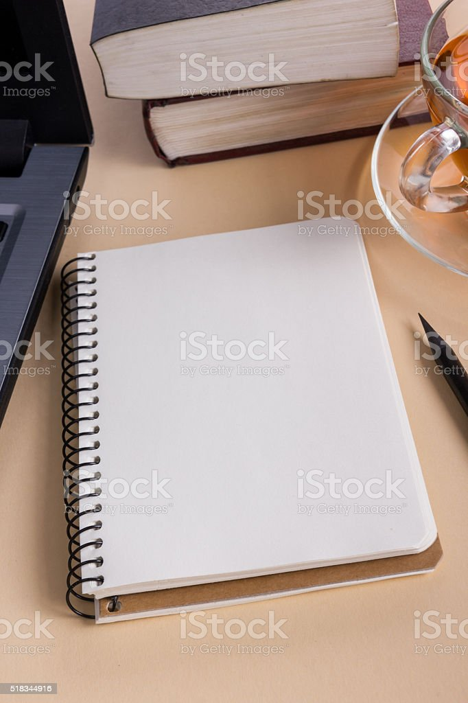 White blank paper notepad book at office worplace. Copy space stock photo