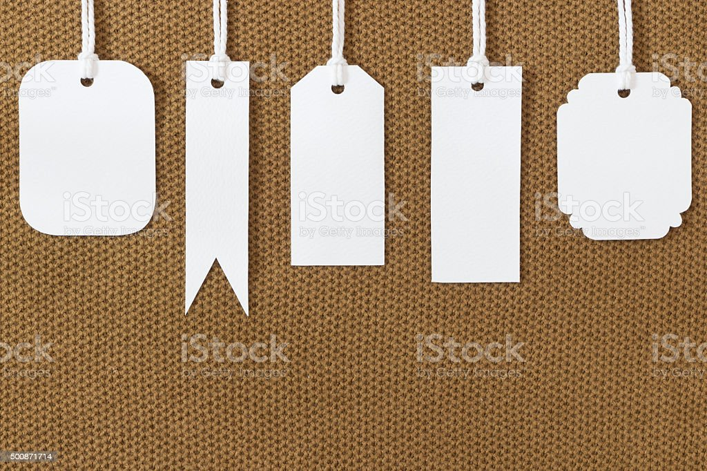white blank tags label on fabric texture stock photo