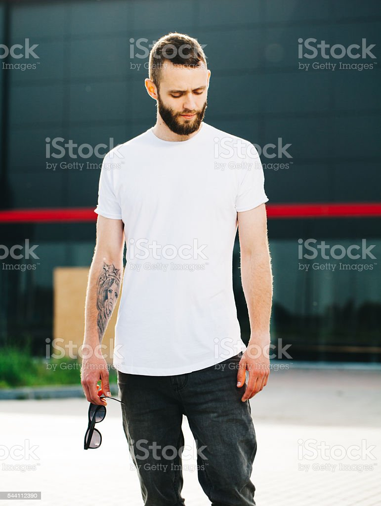 White blank t-shirt on a man stock photo