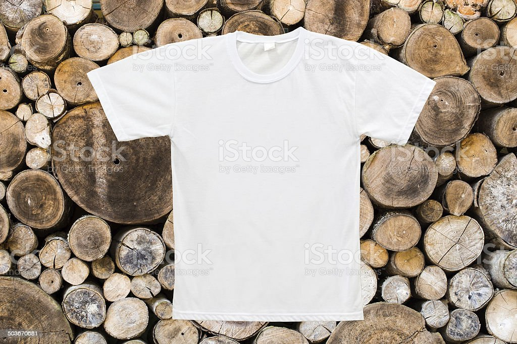 White blank T-shirt on wood texture background stock photo