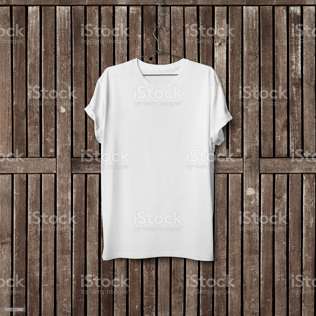 White blank t-shirt on wood wall stock photo