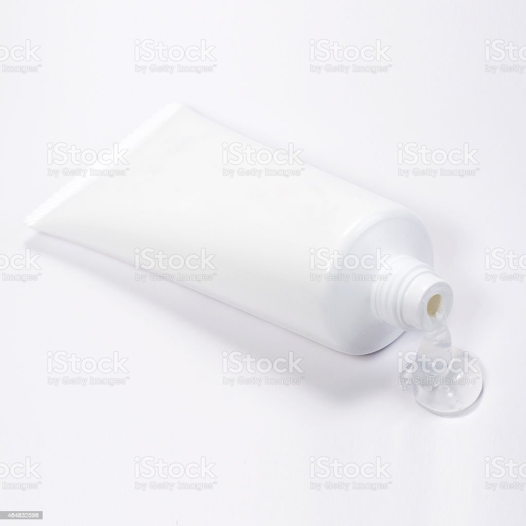 White blank tube with clear gel on a white background stock photo