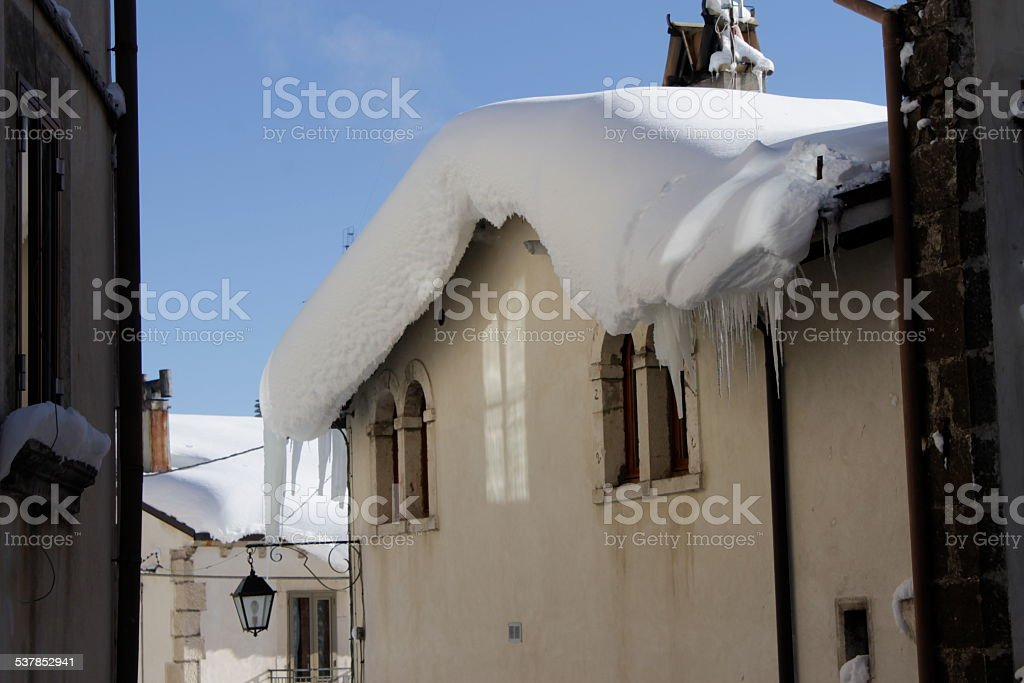 White blanket of snow on the roof stock photo