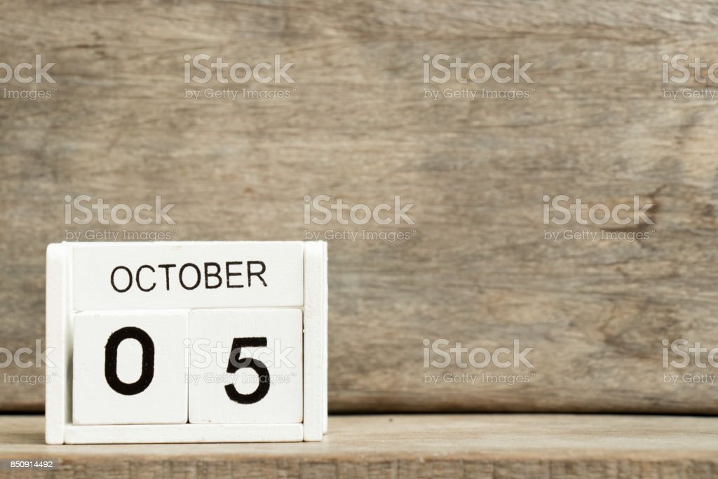 White block calendar present date 5 and month October on wood background (World teacher day) stock photo