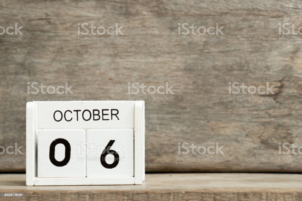 White block calendar present date 6 and month October on wood background (American-German day) stock photo