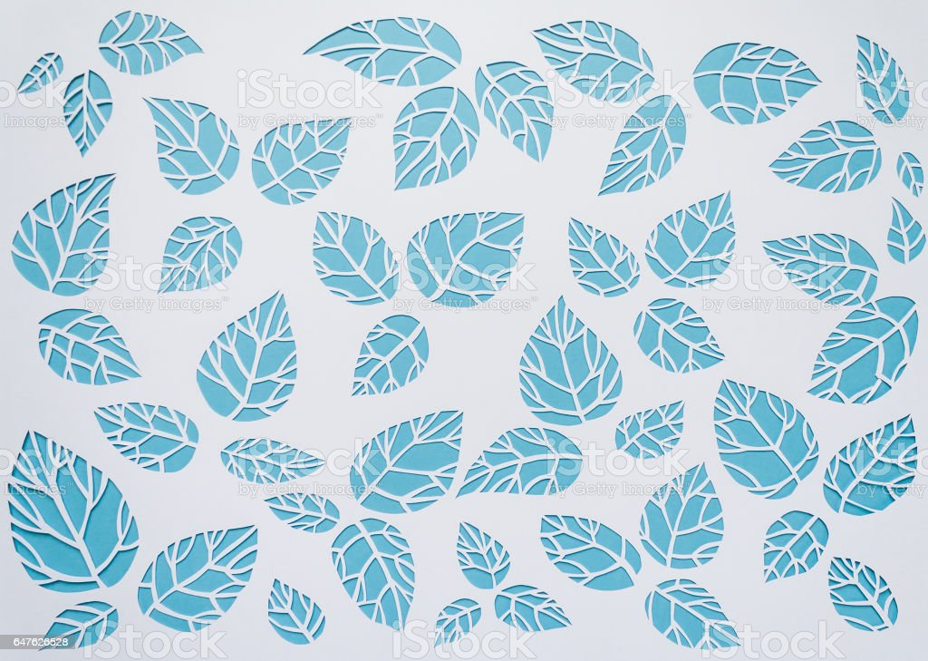 white, blue background leaves. leaves cut from paper stock photo
