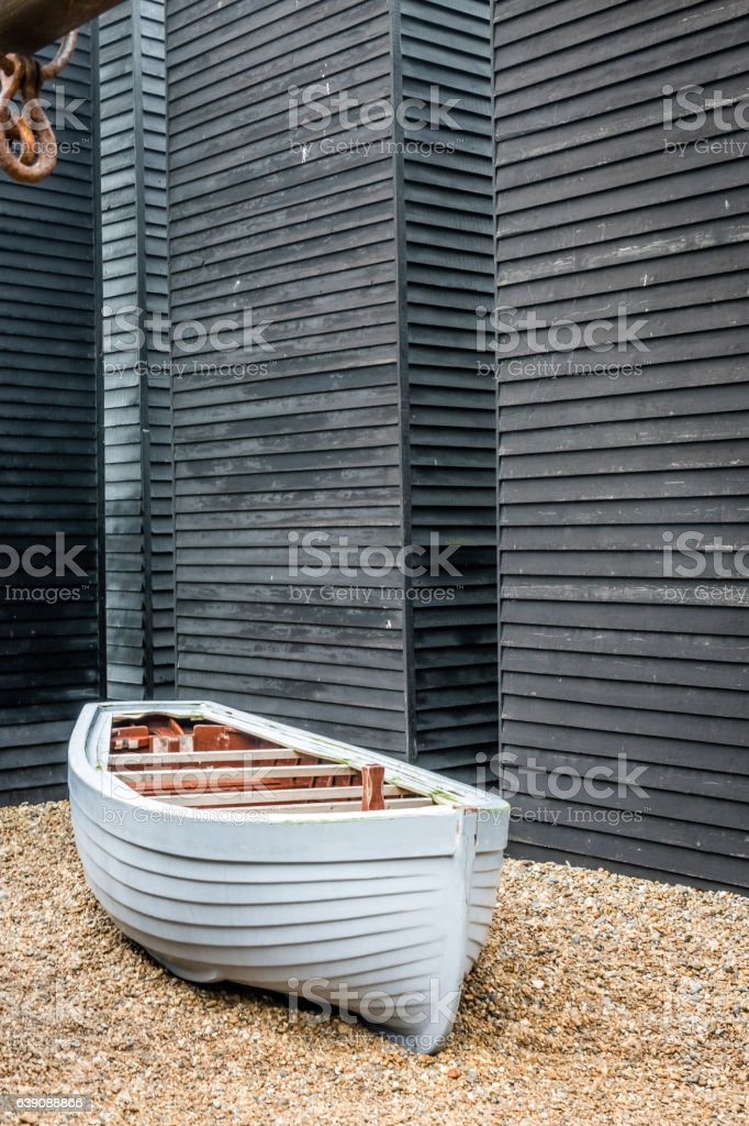 White boat and the old fishermans wooden huts stock photo