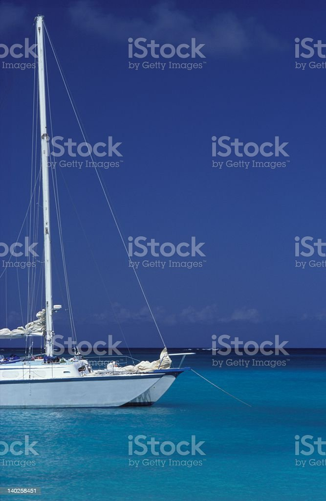 A white boat on the sea on a clear day royalty-free stock photo