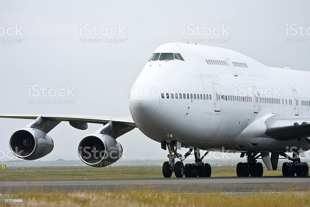 White Boeing 747 jumbo jet on the runway stock photo
