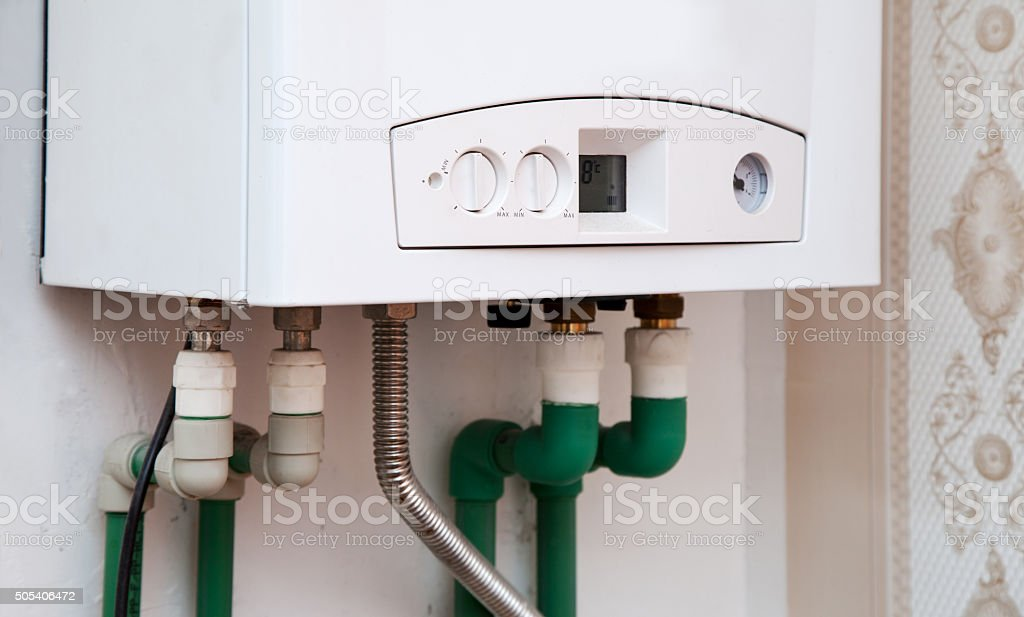 white boiler on the wall stock photo