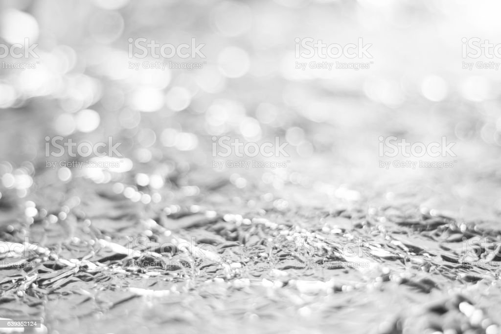 white bokeh from foil paper background texture stock photo