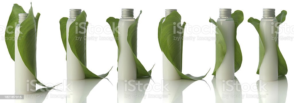 White bottles and leaves royalty-free stock photo