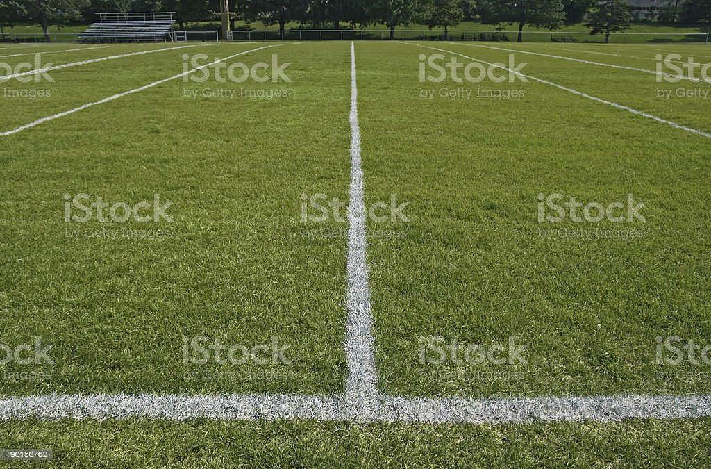 White boundary lines of football playing field stock photo
