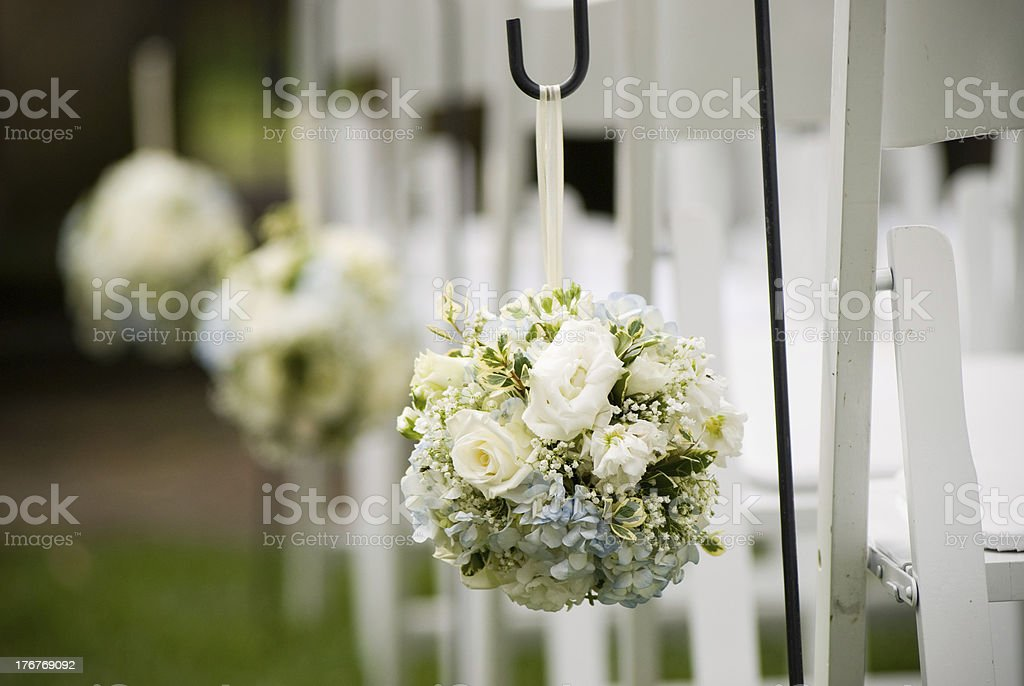 White bouquets hanging off white chairs royalty-free stock photo