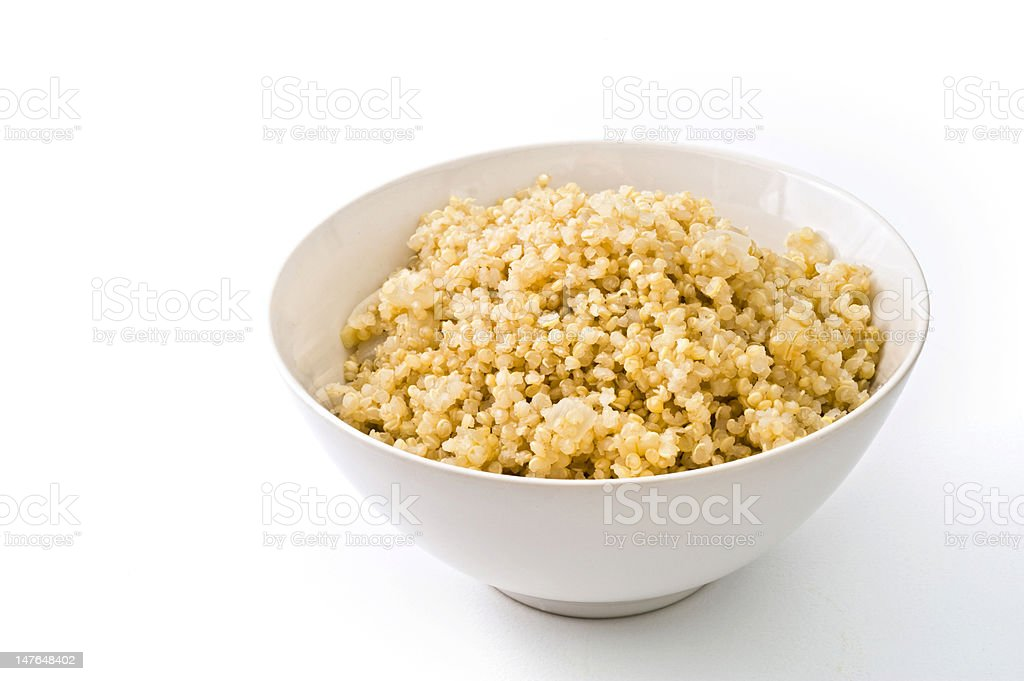A white bowl filled with cooked quinoa royalty-free stock photo