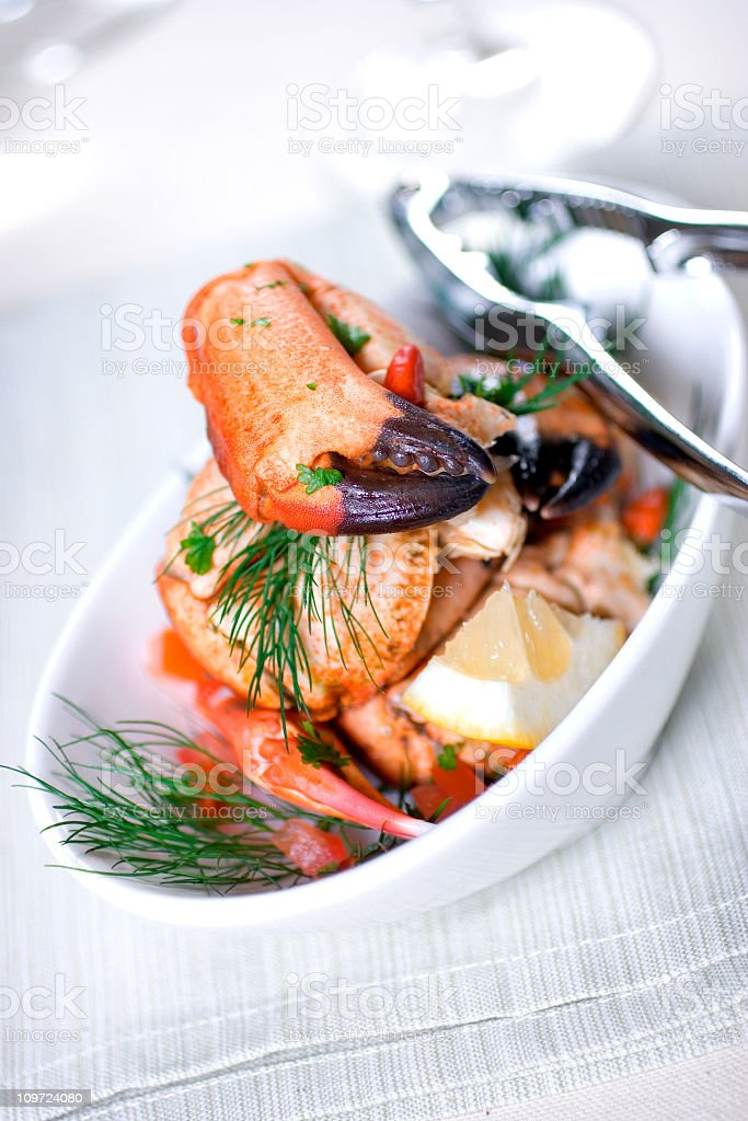 White bowl filled with crab claws stock photo