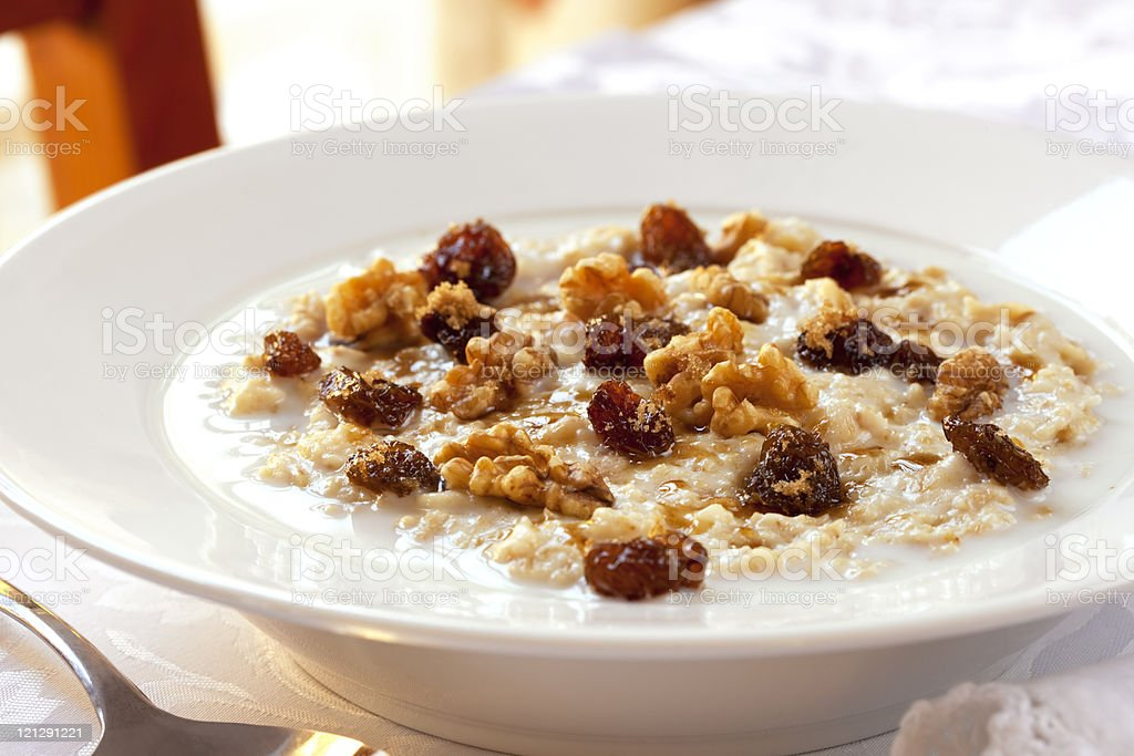 A white bowl filled with oatmeal stock photo