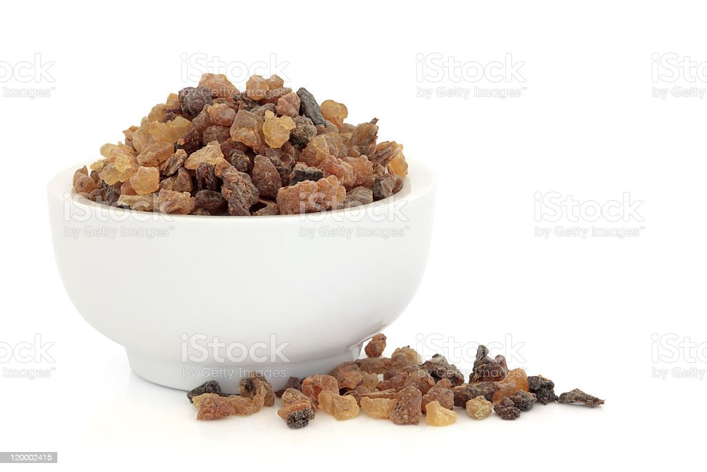 A white bowl full of dried fruits stock photo