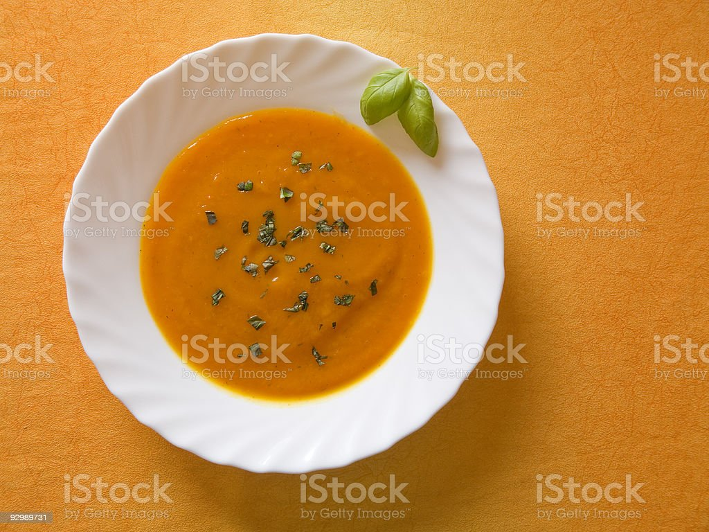 A white bowl full of fresh spiced pumpkin soup royalty-free stock photo