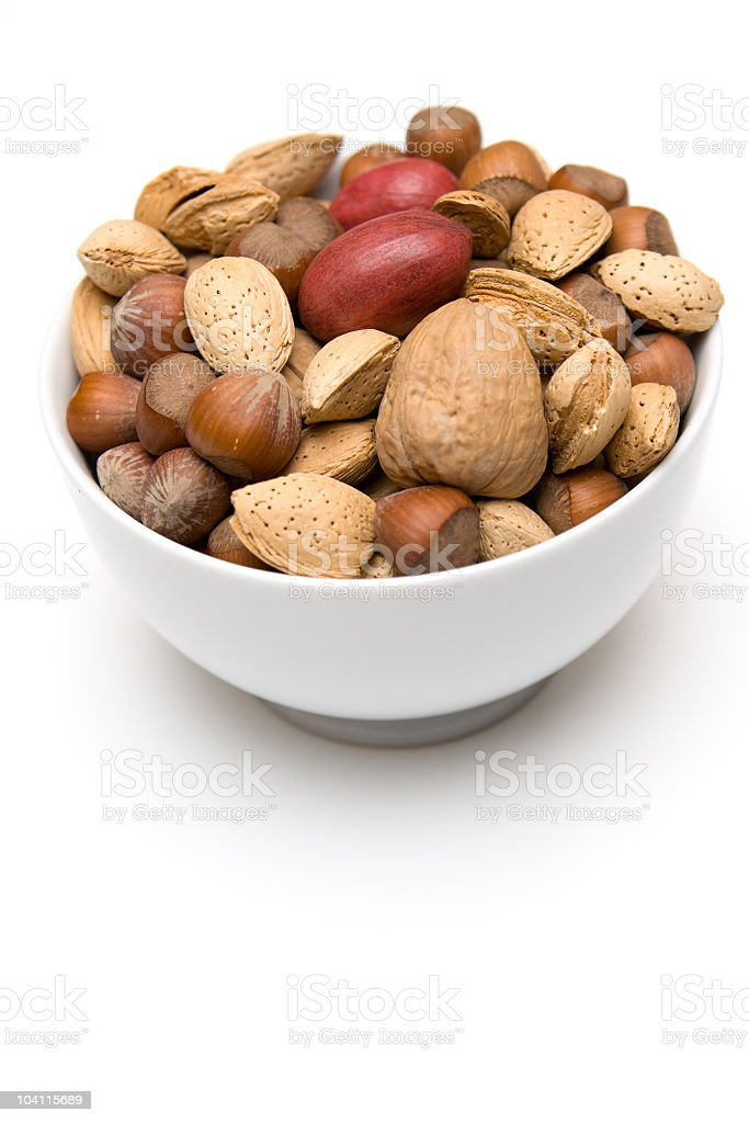 White bowl of mixed nuts on white background royalty-free stock photo