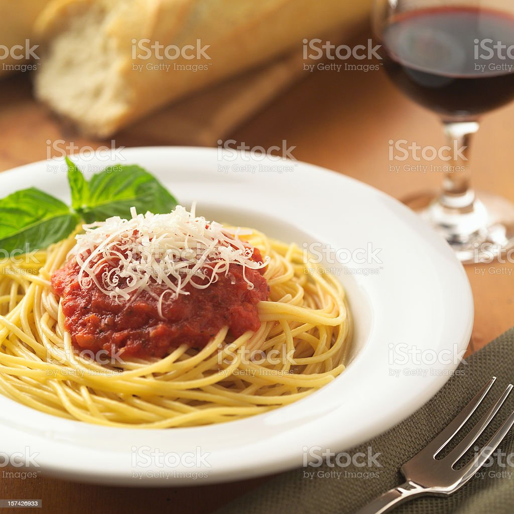 A white bowl of spaghetti noodles with red sauce and cheese royalty-free stock photo
