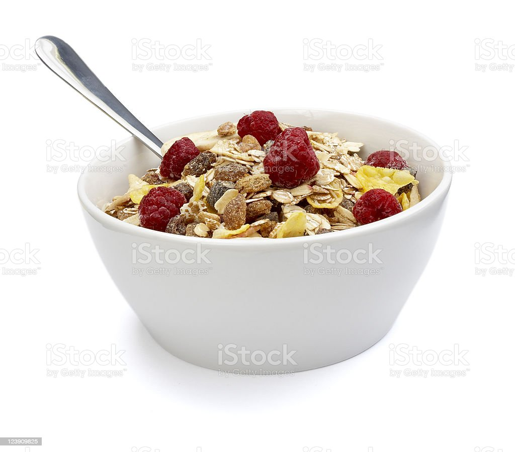 A white bowl with cereal strawberries stock photo