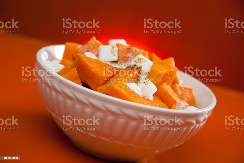 White bowl with cooked yams and marshmallows stock photo