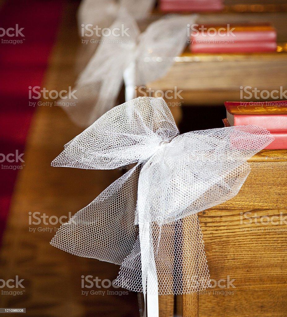 White bows in Catholic Church. stock photo