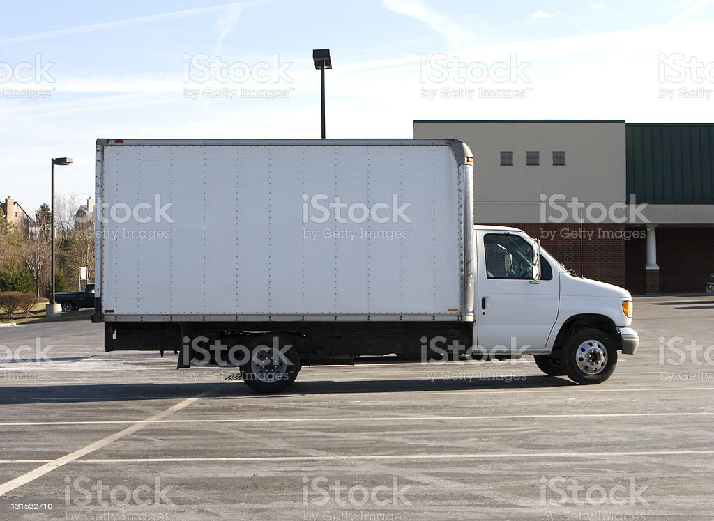 White box truck by itself in parking lot stock photo