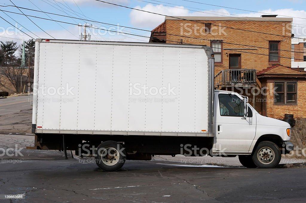 White box truck parked on street stock photo