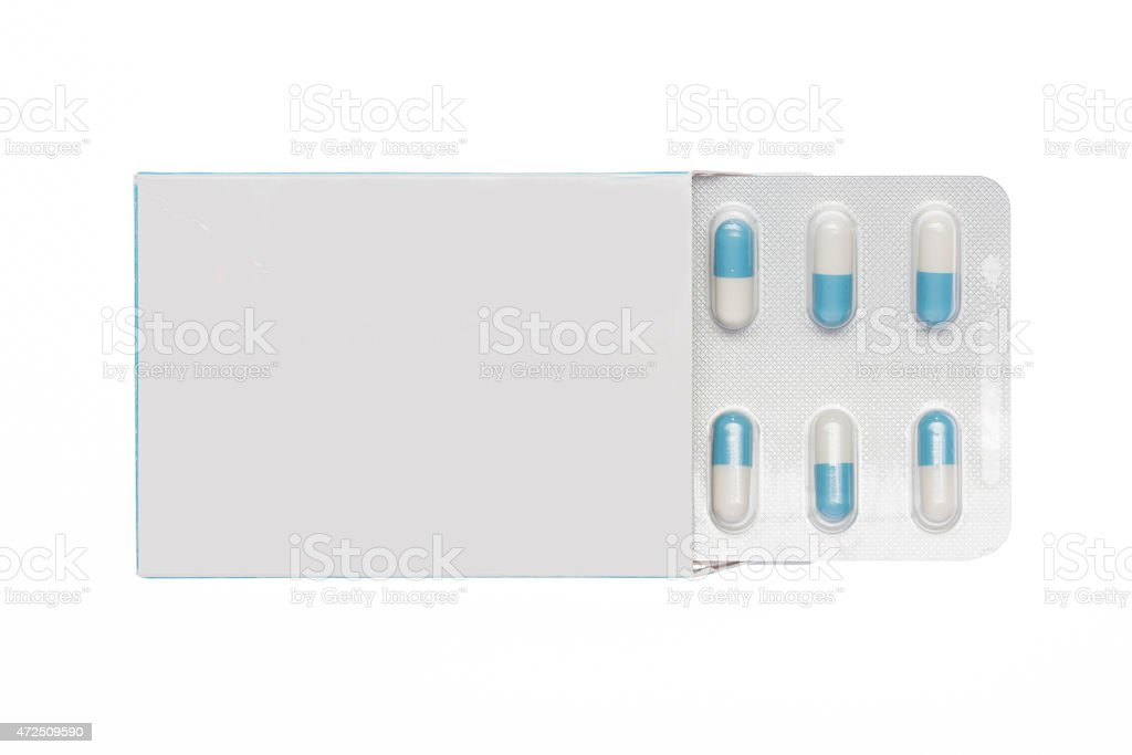 White box with white-blue capsules blister stock photo