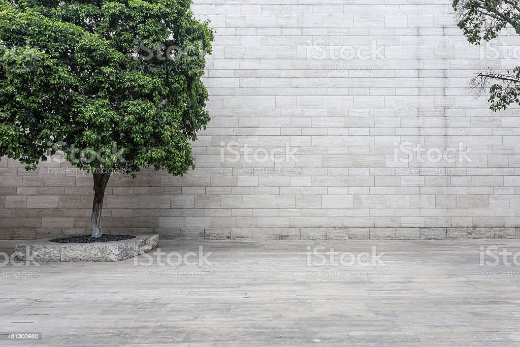 white brick wall and empty sandstone road stock photo