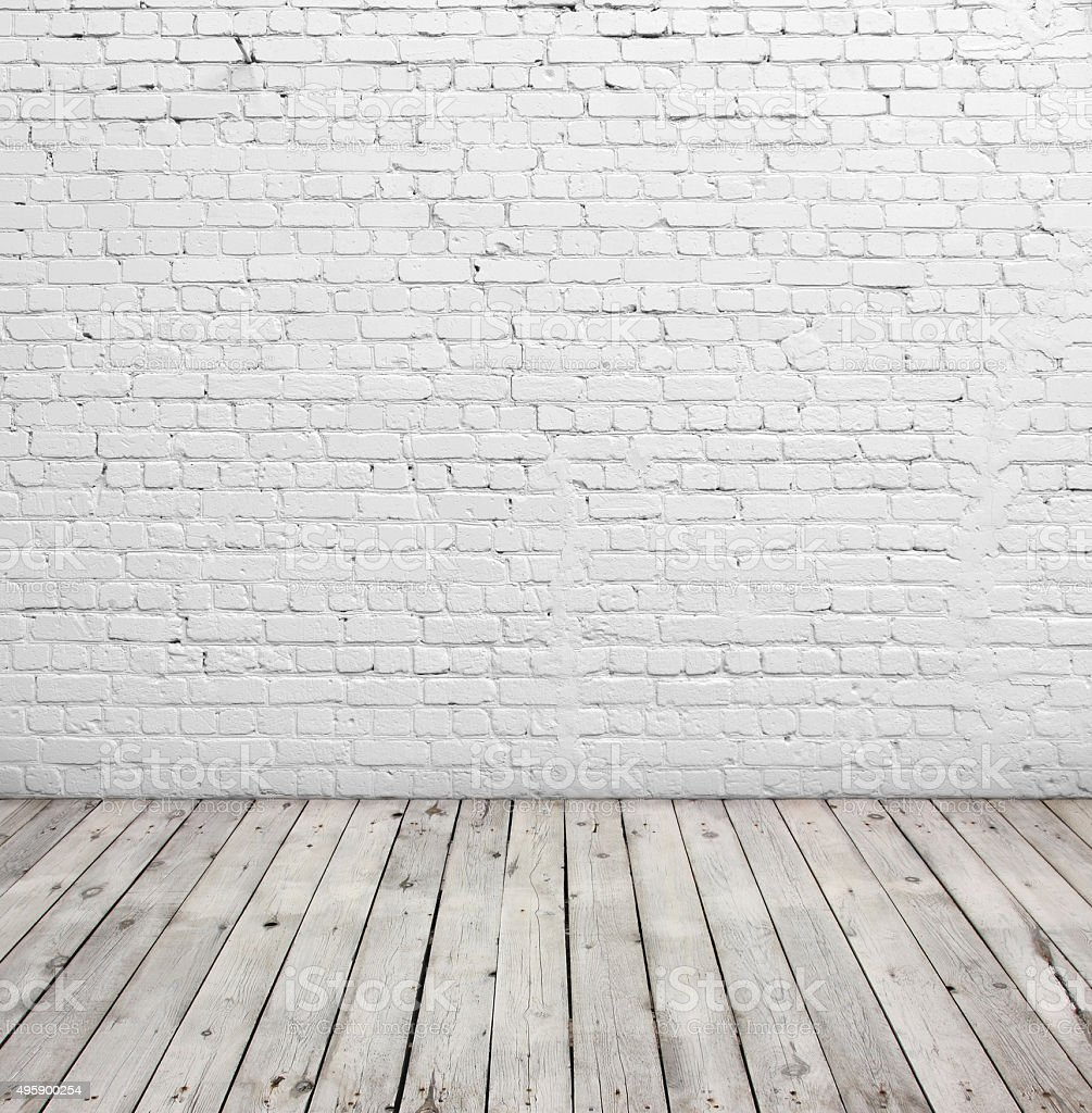 White brick wall and wood floor. stock photo