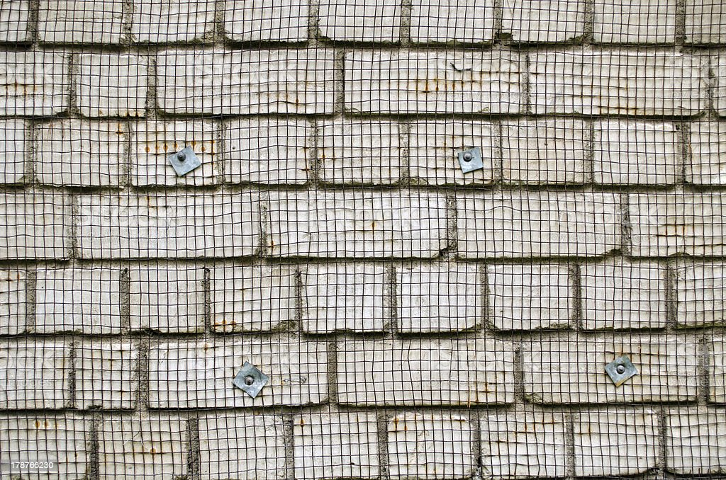 white brick wall metal wire net attached renovate royalty-free stock photo