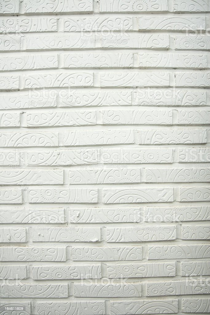 white brick wall with indented pattern stock photo