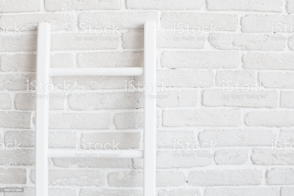 White brick wall with ladder stock photo