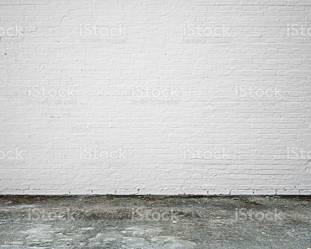 white brick wall with moosy floor indoor stock photo