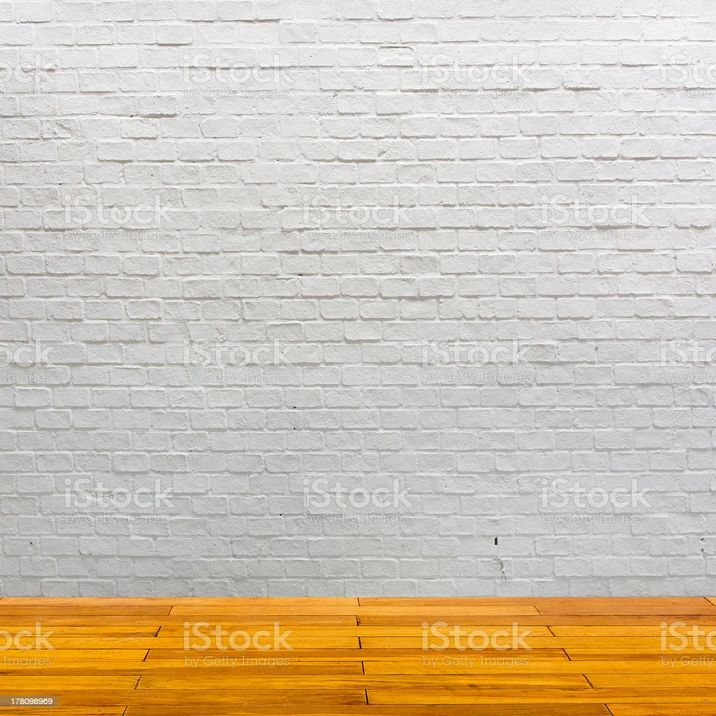White brick wall with wooden floor royalty-free stock photo